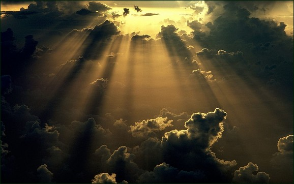 Sun Rays Coming From Dark Clouds