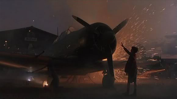 Jamie with plane and sparks from arc welder